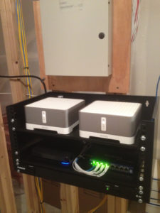 2 sonos connect in a utility room on a small rack