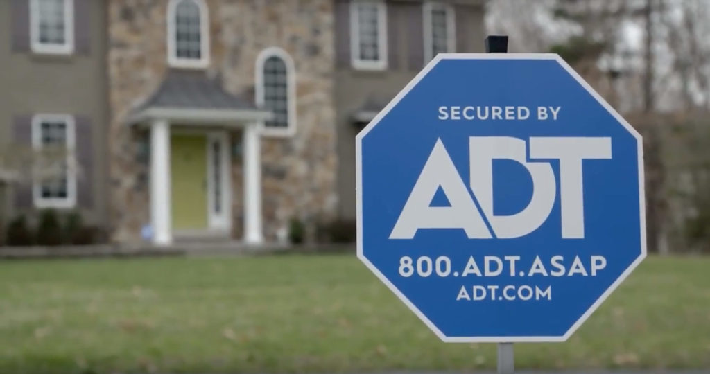 ADT Sign in front of house