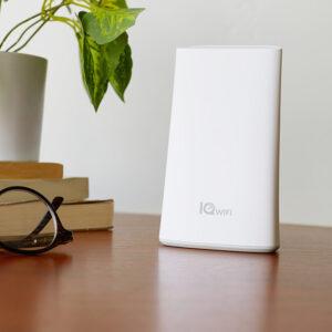 IQ WiFi Mesh Router on desk